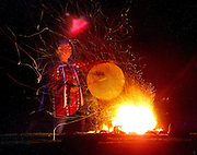 Steve Vincent of Falls, City, Oregon, drums in the darkness about a sacred fire circle. He and wife Cindy are Winnimem Wintu Indians and have a sacred fire circle, sweat lodge and teepee  overlooking the Willamette forest land just below their property.