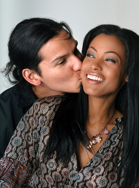Young man kissing his girlfriend very happy.
