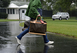 September 2, 2017 - Washington, District of Columbia, United States of America - A White House aide carries Louis Vuitton bags prior to United States President Donald J. Trump and first lady Melania Trump's departure from the White House. (Credit Image: © Olivier Douliery/CNP via ZUMA Wire)