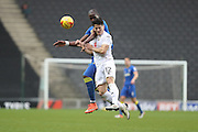 AFC Wimbledon striker Tom Elliott (9) and Milton Keynes Dons defender George B Williams (12) during the EFL Sky Bet League 1 match between Milton Keynes Dons and AFC Wimbledon at Stadium MK, Milton Keynes, England on 10 December 2016. Photo by Stuart Butcher.