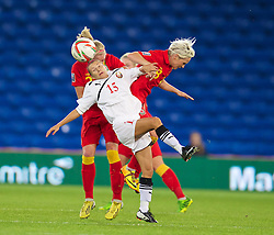 CARDIFF, WALES - Thursday, September 26, 2013: Wales' captain Jessica Fishlock in action against Belarus' Maryia Busunova during the FIFA Women's World Cup Canada 2015 Qualifying Group 6 match at the Cardiff City Stadium. (Pic by David Rawcliffe/Propaganda)
