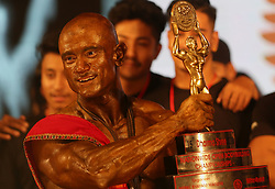 October 6, 2018 - Kathmandu, Nepal - Milan Bikram Sijapati holds trophy after winning the title during the final round of 15th Dharmashree National bodybuilding championship. More than one hundred men across country participate in the body building championship. (Credit Image: © Archana Shrestha/Pacific Press via ZUMA Wire)