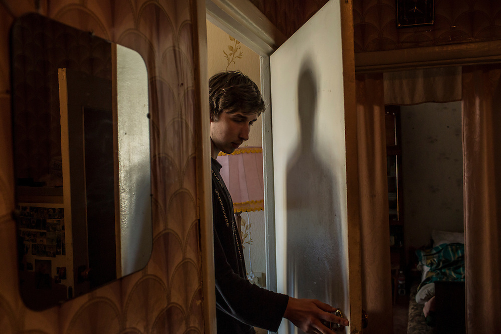LUHANSK, UKRAINE - MARCH 16, 2015: Pavel Pavlov in the apartment where he lives with his mother in Luhansk, Ukraine. CREDIT: Brendan Hoffman for The New York Times
