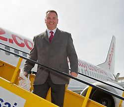 CARDIFF, WALES - Wednesday, September 1, 2010: ATP travel organiser Cliff Jones boards the plane at Cardiff Airport as the Wales national team fly out to Podgorica ahead of the opening UEFA Euro 2012 Qualifying Group 4 match against Montenegro. (Pic by David Rawcliffe/Propaganda)