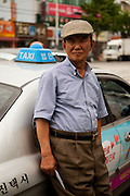 Portrait of a cab driver in the city center of Daegu. Daegu, also known as Taegu and officially the Daegu Metropolitan City, is the third largest metropolitan area in South Korea, and by city limits, the fourth largest city with over 2.5 million people. The IAAF World Championships in Athletics will take place in Daegu from the 27th of August till the 4th of September 2011.