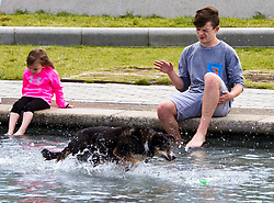 Pictured: Holly the dog was having fun in the water as owner Gail Middleton and friends enjoyed getting cooled down.<br /> <br /> <br /> <br /> Ger Harley   EEm date
