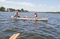 Alex Schibli with his wife Noelva Vigoya visit his island - Rat Island for a picnic on June 15, 2012 ..They are canoing out to the island in this shot.