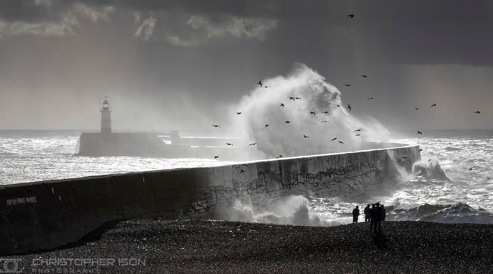 Waves crash over the sea wall at Newhaven, East Sussex.