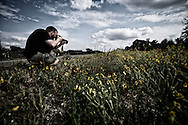 Yngve taking pictures of flowers in Texas.