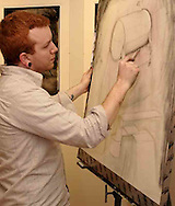 Nick Satinover, from Kettering works on a drawing at the 2007 Arts Gala at Wright State University, Saturday evening..