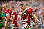 Wigan Warriors centre Oliver Gildart (4) scores a try and celebrates to make the score 16-14 during the Ladbrokes Challenge Cup Final 2017 match between Hull RFC and Wigan Warriors at Wembley Stadium, London, England on 26 August 2017. Photo by Simon Davies.