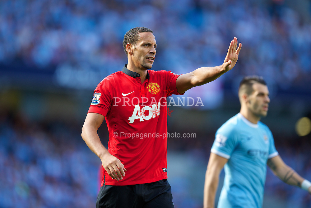 MANCHESTER, ENGLAND - Sunday, September 22, 2013: Manchester United's Rio Ferdinand in action against Manchester City during the Premiership match at the City of Manchester Stadium. (Pic by David Rawcliffe/Propaganda)
