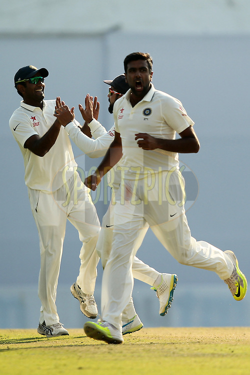 Ravichandran Ashwin of India celebrates wicket of Alastair Cook captain of England during day 3 of the third test match between India and England held at the Punjab Cricket Association IS Bindra Stadium, Mohali on the 28th November 2016.Photo by: Prashant Bhoot/ BCCI/ SPORTZPICS