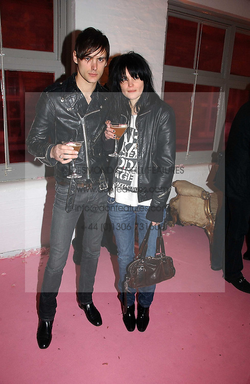 ALISON MOSSHART and FINN VINE at a dinner hosted by Harpers Bazaar to celebrate the launch of the fragrance Flowerbomb by Viktor &amp; Rolf held at Elms lester, Flitcroft Street, London WC2 on 31st May 2006.<br />