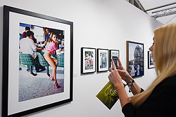 "London, UK.  17 May 2017. A visitor views ""Kate Moss, Los Angeles, CA"", Vogue, 1995 by Arthur Elgort.  Preview of Photo London 2017 at Somerset House.  Held for the third time, the event showcases the best in contemporary photography, from 89 galleries from 16 different countries, for collectors and enthusiasts and will be on from 18 - 21 May. Credit: Stephen Chung / Alamy Live News"