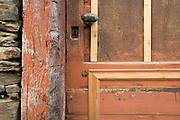 old rusty doorknob and keyhole