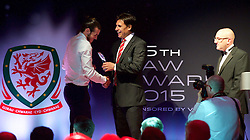 CARDIFF, WALES - Monday, October 5, 2015: Wales' Gareth Bale receive the Players' Player of the Year Award from manager Chris Coleman during the FAW Awards Dinner at Cardiff City Hall.. (Pic by Ian Cook/Propaganda)