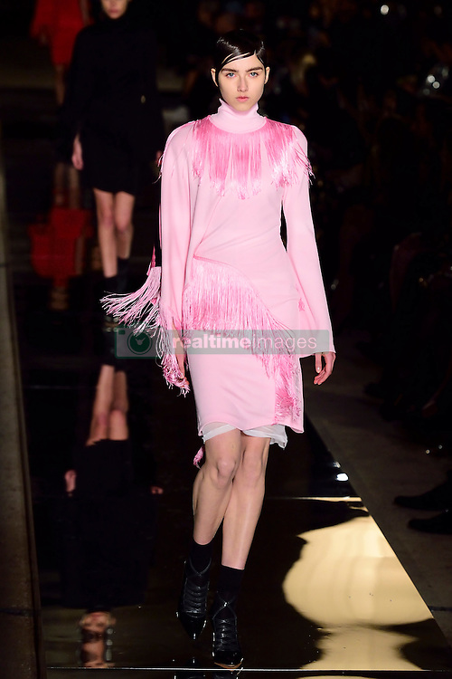 A model walks the runway during the Givenchy show as a part of Paris Fashion Week Ready to Wear Spring/Summer 2017 in Paris, France on October 02, 2016. Photo by Aurore Marechal/ABACAPRESS.COM  | 565449_044 Paris France