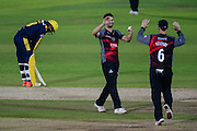 Lewis Gregory and Jim Allenby of Somerset celebrate the wicket of Brad Wheal of Hampshire during the Royal London One Day Cup match between Hampshire County Cricket Club and Somerset County Cricket Club at the Ageas Bowl, Southampton, United Kingdom on 2 August 2016. Photo by David Vokes.