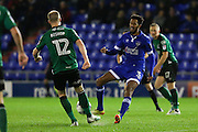 Scunthorpe United midfielder Neil Bishop (12) clears the ball under pressure from Jamie Reckord of Oldham Athletic during the EFL Sky Bet League 1 match between Oldham Athletic and Scunthorpe United at Boundary Park, Oldham, England on 18 October 2016. Photo by Simon Brady.