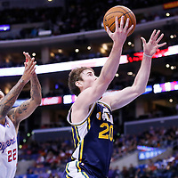 01 February 2014: Utah Jazz shooting guard Gordon Hayward (20) goes for the layup past Los Angeles Clippers small forward Matt Barnes (22) during the Los Angeles Clippers 102-87 victory over the Utah Jazz at the Staples Center, Los Angeles, California, USA.