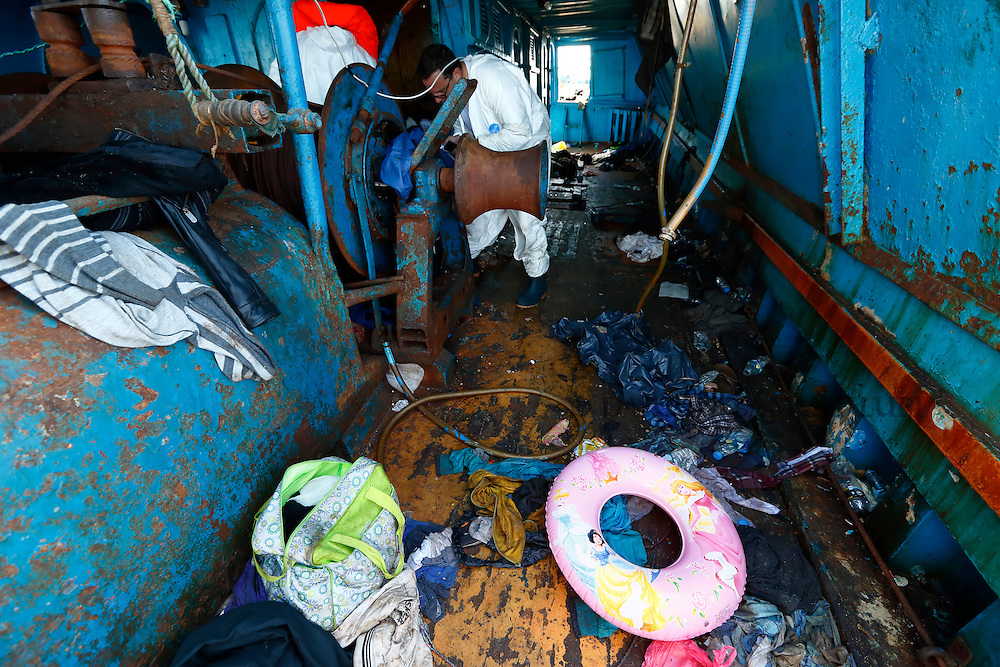 Migrants' belongings, including a child's buoyancy ring, litter the deck of a wooden boat from which migrants were rescued 10.5 miles (16 kilometres) off the coast of Libya August 6, 2015.  An estimated 600 migrants on the boat were rescued by the international non-governmental organisations Medecins san Frontiere (MSF) and the Migrant Offshore Aid Station (MOAS) without loss of life on Thursday afternoon, according to MSF and MOAS, a day after more than 200 migrants are feared to have drowned in the latest Mediterranean boat tragedy after rescuers saved over 370 people from a capsized boat thought to be carrying 600.<br /> REUTERS/Darrin Zammit Lupi <br /> MALTA OUT. NO COMMERCIAL OR EDITORIAL SALES IN MALTA