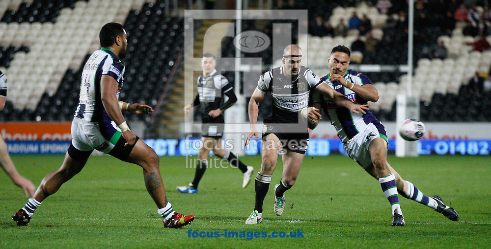 Danny Houghton (centre) of Hull Football Club is closed down by Adam Henry (right) of Bradford Bulls during the First Utility Super League match at the KC Stadium, Kingston upon Hull<br /> Picture by Richard Gould/Focus Images Ltd +44 7855 403186<br /> 07/03/2014
