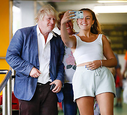 © Licensed to London News Pictures. 11/08/2018. Crawley, UK. BORIS JOHNSON is seen posing for a phone photo at Gatwick Airport after returning from a short visit to Italy. The former foreign secretary has been criticised for language he used in a national newspaper column to describe women wearing the burka. Photo credit: London News Pictures