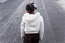 Back view of young girl alone,