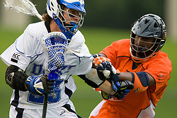 Virginia midfielder Rhamel Bratton (3) defends Duke midfielder Sam Solie (23).  The #2 ranked Duke Blue Devils defeated the #3 ranked Virginia Cavaliers 11-9 in the finals of the Men's 2008 Atlantic Coast Conference tournament at the University of Virginia's Klockner Stadium in Charlottesville, VA on April 27, 2008.