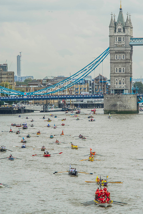 The royal barge Jubilant leads a large group of boats past Tower Bridge. The Great River Race, London's River Marathon (also known as The UK Traditional Boat Championship) - a 21.6 Miles boat race up the River Thames from London Docklands to Ham in Surrey. It attracts over 300 crews from all over the globe and appeals to every level of competitor from those who enjoy fun, fancy dress and charity stunts, to serious sportsmen. River Thames, London, 27 September 2014.