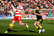 Doncaster Rovers midfielder Jordan Houghton (16), on loan from Chelsea, chased down by Rotherham United midfielder Jon Taylor (11)  during the EFL Sky Bet League 1 match between Doncaster Rovers and Rotherham United at the Keepmoat Stadium, Doncaster, England on 11 November 2017. Photo by Simon Davies.