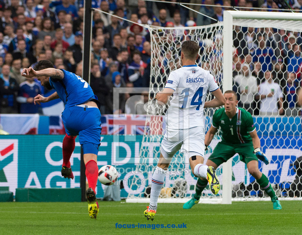 Olivier Giroud of France shoots and scores France's first goal against Iceland during the UEFA Euro 2016 quarter final match at Stade de France, Paris<br /> Picture by Anthony Stanley/Focus Images Ltd 07833 396363<br /> 03/07/2016