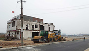 LUOYANG, CHINA - MAY 16: (CHINA OUT) <br /> <br /> Nail House Hangs National Flag To Obstruct Road Construction<br /> <br /> A three-storeied house stands at central road which forces the road construction to stop on in Luolong District on May 16, 2015 in Luoyang, Henan province of China. A nail house in Luoyang of China\'s Henan province refused to move out due to the reason that he was on satisfied with the compensation plan by the local government and had not reached any agreement for two years which postponed the opening of main road. It\'s said that the owner of the nail house insisted on not move two years ago the road project started while the supring thing was that he still held on and carried water for meals from other places. <br /> ©Exclusivepix Media