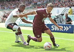 24.07.2010, Fritz-Walter Stadion, Kaiserslautern, GER, 1. FBL, Friendly Match, 1.FC Kaiserslautern vs FC Liverpool, im Bild David AMOO (Liverpool #7) im Zweikampf mit Ivo ILICEVIC (Kaiserslauern #22 KRO), EXPA Pictures © 2010, PhotoCredit: EXPA/ nph/  Roth+++++ ATTENTION - OUT OF GER +++++ / SPORTIDA PHOTO AGENCY