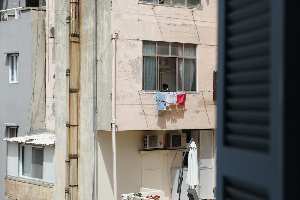 Since many domestic workers are not allowed a break away from work by their employers, photographing them is only possible from balconies.