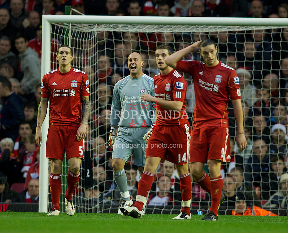 LIVERPOOL, ENGLAND - Boxing Day Monday, December 26, 2011: Liverpool's Daniel Agger, goalkeeper Jose Reina, Jordan Henderson and Andy Carroll look dejected as Blackburn Rovers score the opening goal during the Premiership match at Anfield. (Pic by David Rawcliffe/Propaganda)