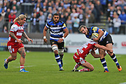 Gloucester lock Tom Savage (4) does a crunching tackle on  Bath centre Max Clarke (12) during the Aviva Premiership match between Bath Rugby and Gloucester Rugby at the Recreation Ground, Bath, United Kingdom on 29 October 2017. Photo by Gary Learmonth.
