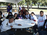 Sharpstown International students team up with Mi Familia Vota at Bayland Park to get the word out about early voting.<br />