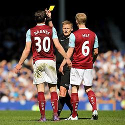 Burnley's Ashley Barnes receives a yellow card  - Photo mandatory by-line: Matt McNulty/JMP - Mobile: 07966 386802 - 18/04/2015 - SPORT - Football - Liverpool - Goodison Park - Everton v Burnley - Barclays Premier League