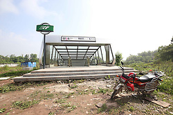 CHONGQING, CHINA - MAY 08: ..Metro Station Opens At Wasteland..The exit one of Caojiawan Station on Chongqing Rail Transit Line 6 is seen at a wasteland on May 8, 2017 in Chongqing, China. The metro station exits hidden at a wasteland in Chongqing. Caojiawan Station on Chongqing Rail Transit Line 6, opened one exit in 2015. As few passengers board from Caojiawan Station, other two exits are hardly seen in the grass, and there's no path leading to the station on the wasteland. .©Exclusivepix Media (Credit Image: © Exclusivepix media via ZUMA Press)