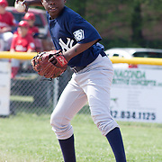 04/14/12 Newark Del. Yankees short stop Kedrick Whilehead #10 attempts to throw to first base in the second inning of a Canal L.L. League game against the Angels Saturday, April. 14, 2012 at Canal L.L. Complex in Bear Delaware...Special to The News Journal/SAQUAN STIMPSON