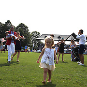 Spectators on the field at half time replacing divots during the White Birch Vs K.I.G Polo match in the Butler Handicap Tournament match at the Greenwich Polo Club. White Birch won the game 11-8. Greenwich Polo Club,  Greenwich, Connecticut, USA. 12th July 2015. Photo Tim Clayton