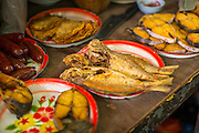 """05 OCTOBER 2012 - BANGKOK, THAILAND: Fried fish for sale on street food vendor's cart. Thailand in general, and Bangkok in particular, has a vibrant tradition of street food and """"eating on the run."""" In recent years, Bangkok's street food has become something of an international landmark and is being written about in glossy travel magazines and in the pages of the New York Times.       PHOTO BY JACK KURTZ"""