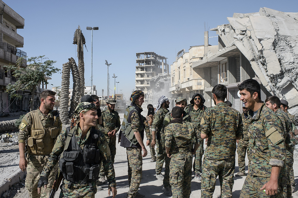 After the liberation of ISIS controlled Raqqa, fighters of the  Syrian Democratic Forces (SDF) gather in a street near Al-Naim Square in Raqqa, Syria, October 18, 2017