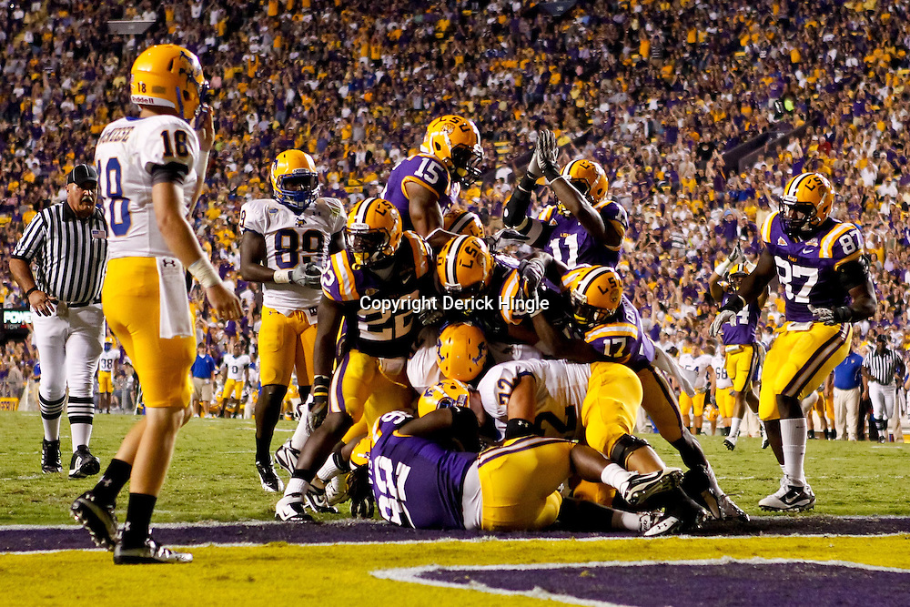 October 16, 2010; Baton Rouge, LA, USA; McNeese State Cowboys running back Andre Anderson (22) is stopped in the endzone for a safety against the LSU Tigers during the first half at Tiger Stadium.  Mandatory Credit: Derick E. Hingle