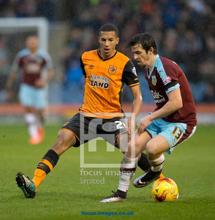 Isaac Hayden of Hull City (centre) closes down Joey Barton of Burnley (right) during the Sky Bet Championship match at Turf Moor, Burnley<br /> Picture by Russell Hart/Focus Images Ltd 07791 688 420<br /> 06/02/2016