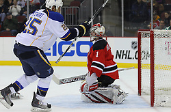 Feb 9; Newark, NJ, USA; St. Louis Blues right wing Chris Stewart scores a goal on New Jersey Devils goalie Johan Hedberg (1) during the first period at the Prudential Center.