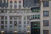 The clock face of the House of Fraser department store and a business meeting on the top floor of corporate offices in late afternoon in the heart of the Square Mile, the capital's historical and financial centre, on 1st November 2017, in the City of London, England.