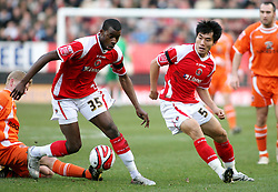 London, England - Saturday, January 12th, 2008:  Charlton Athletic's Zheng Zhi and Izale McLeod in action against Blackpool during the League Championship match at The Valley. (Pic by Chris Ratcliffe/Propaganda)